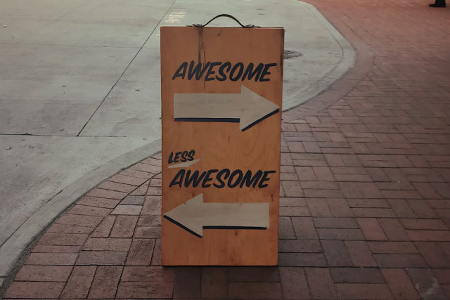 Sign that has an arrow to awesome and one to less awesome