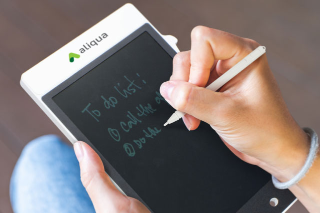 Woman holding promotional e to do list