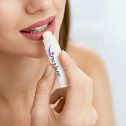 Women applying branded lip balm