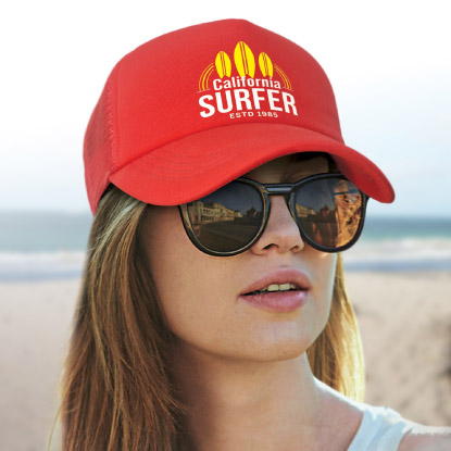 Women at beach wearing promotional trucker cap and glasses