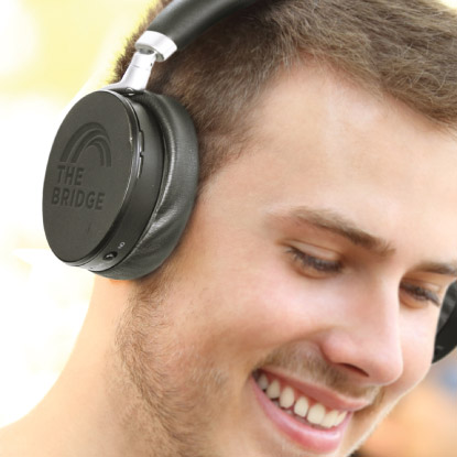 Man smiling with promotional headphones on
