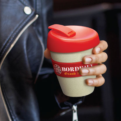 Woman holding promotional wheat husk coffee cup