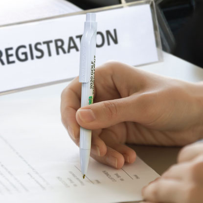 Person using promotional pen for registration