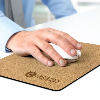 Man using promotional cork mouse mat with wireless mouse