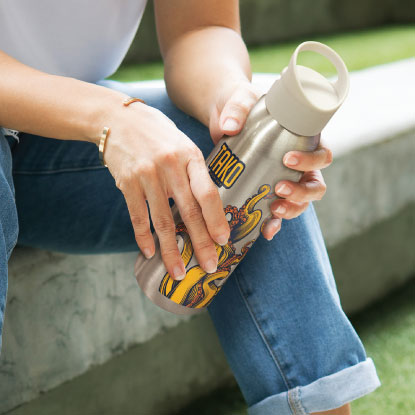 Woman holding silver promotional drink bottle