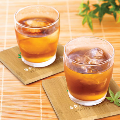 Glass tumblers on promotional bamboo coasters