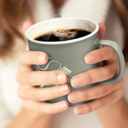 Woman holding promotional coffee mug