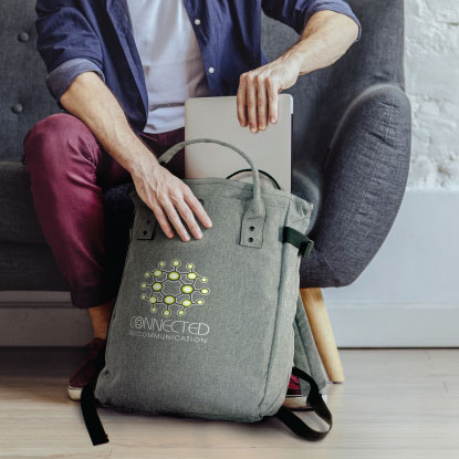 Man putting laptop into promotional backpack